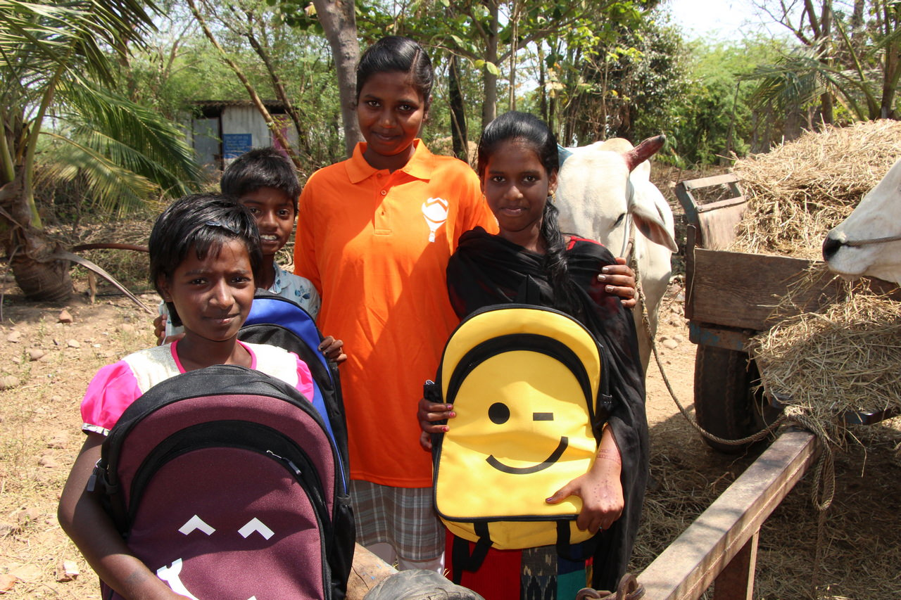 Volunteers share their time and story with young people in the village