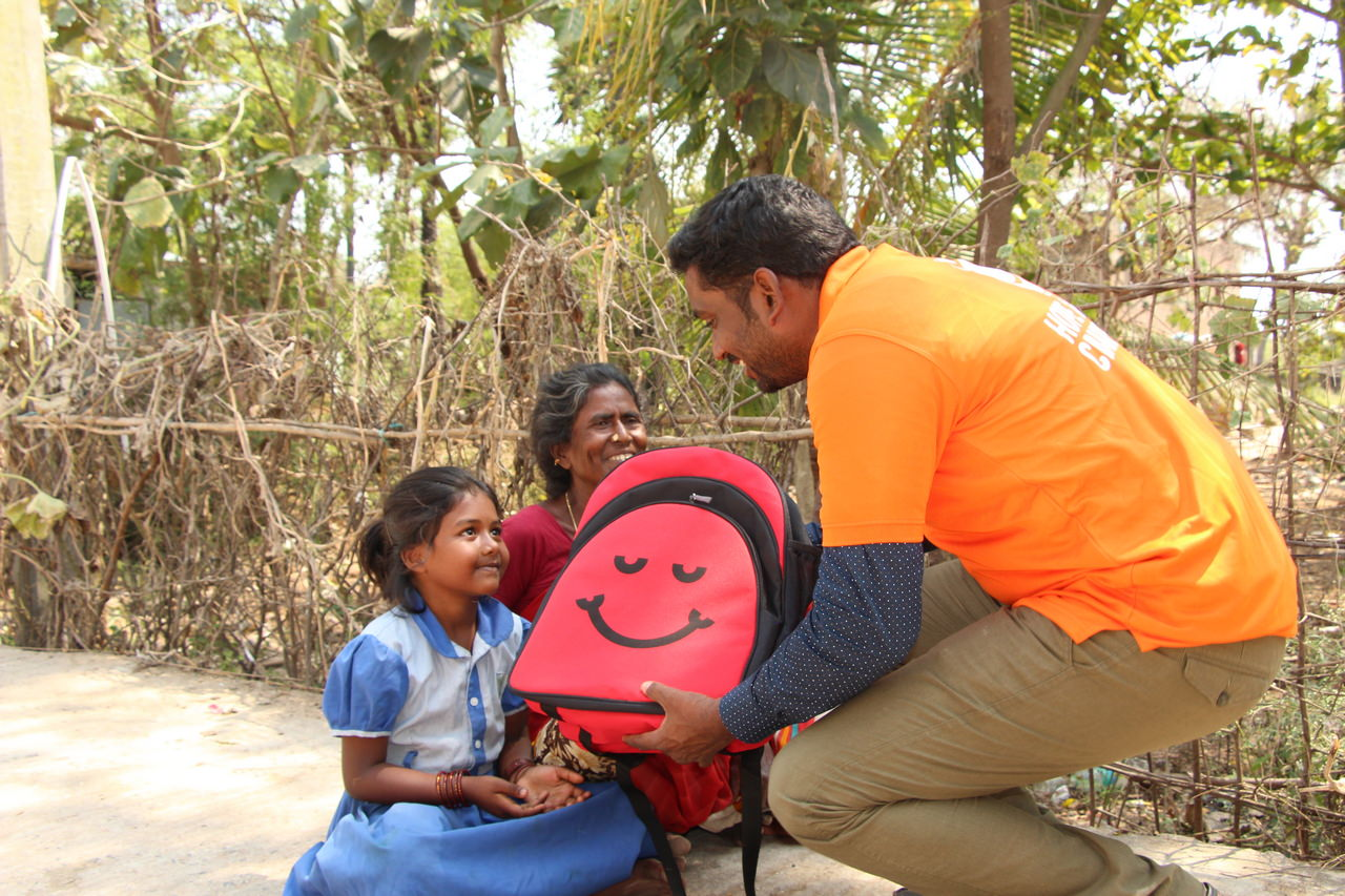Volunteers have the opportunity to meet parents during distribution
