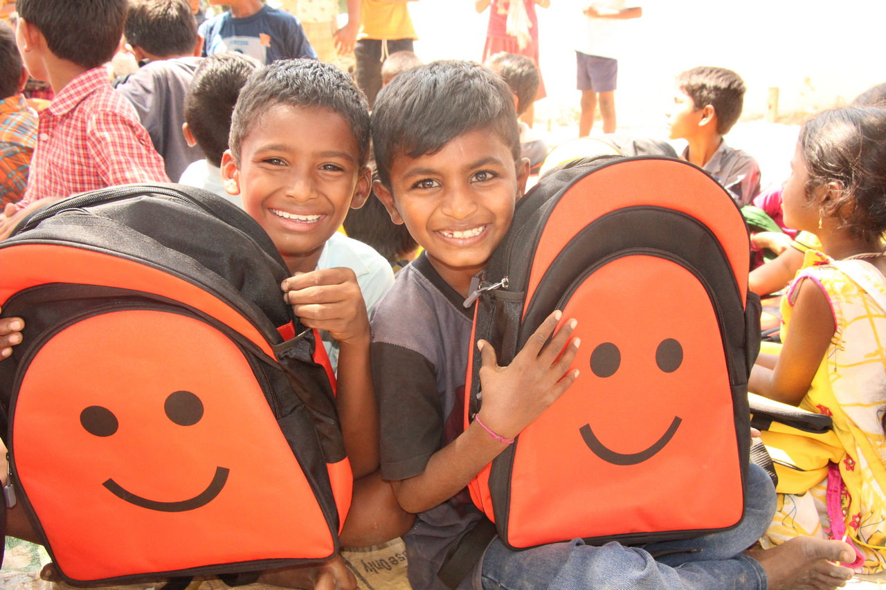 Happy boys with their backpacks