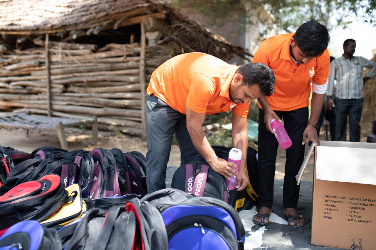 Hope Carrier volunteers fill and prepare backpacks ahead of the distribution