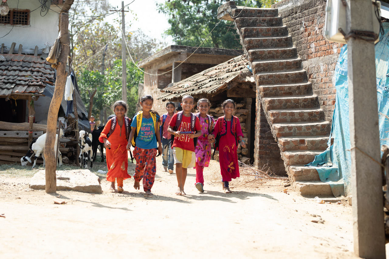 A group of children head home after a successful, joyful distribution